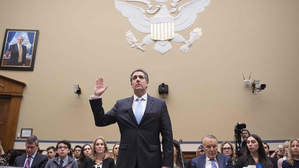 Michael Cohen, US President Donald Trump's former personal attorney, is sworn in to testify before the House Oversight and Reform Committee in the Rayburn House Office Building on Capitol Hill in Washington, DC. (Jim Watson / AFP)