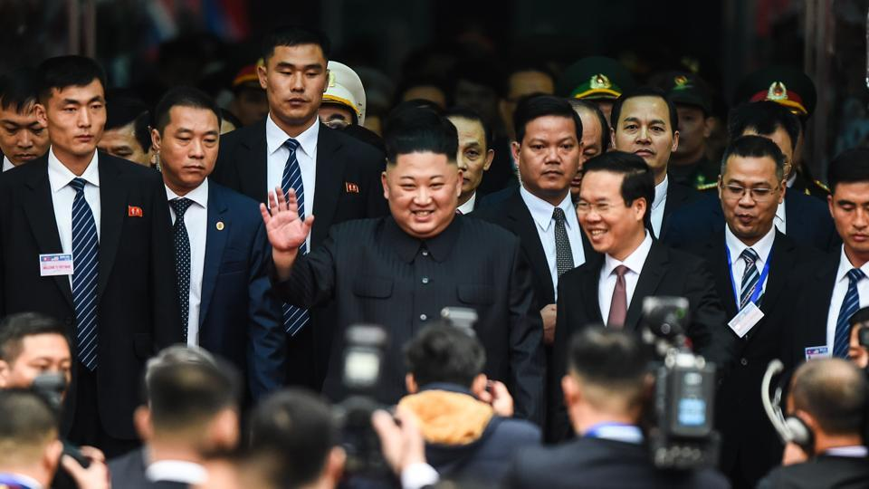 North Korean leader Kim Jong Un (C) waves after arriving at the Dong Dang railway station in Dong Dang, Lang Son province to attend the second US-North Korea summit. (Nhac Nyugen / AFP)