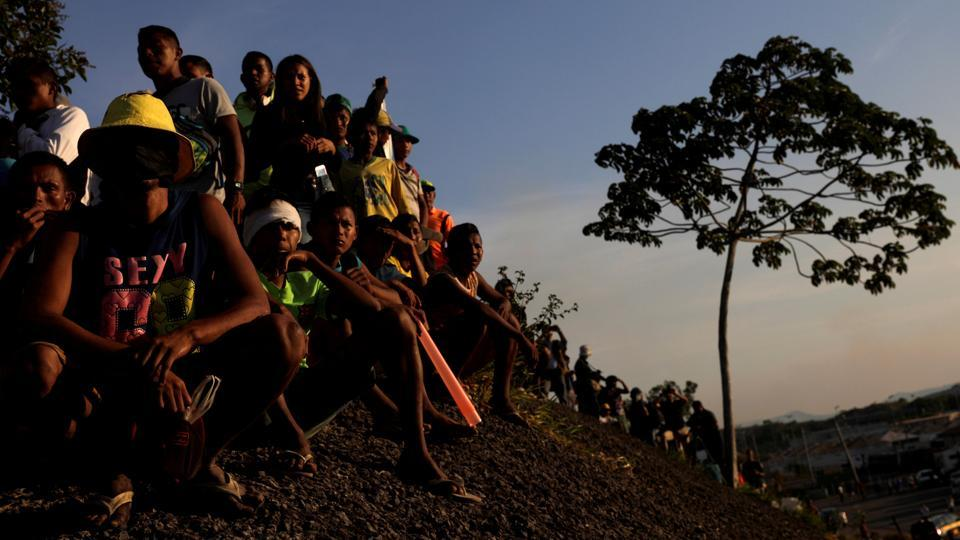 Venezuelan people gather along the border between Venezuela and Brazil in Pacaraima, Brazil. (Ricardo Moraes / REUTERS)