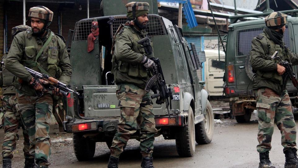 Army soldiers rush near an encounter site where militants hiding at Warpora in Sopore area of Baramulla district. Image for representation.