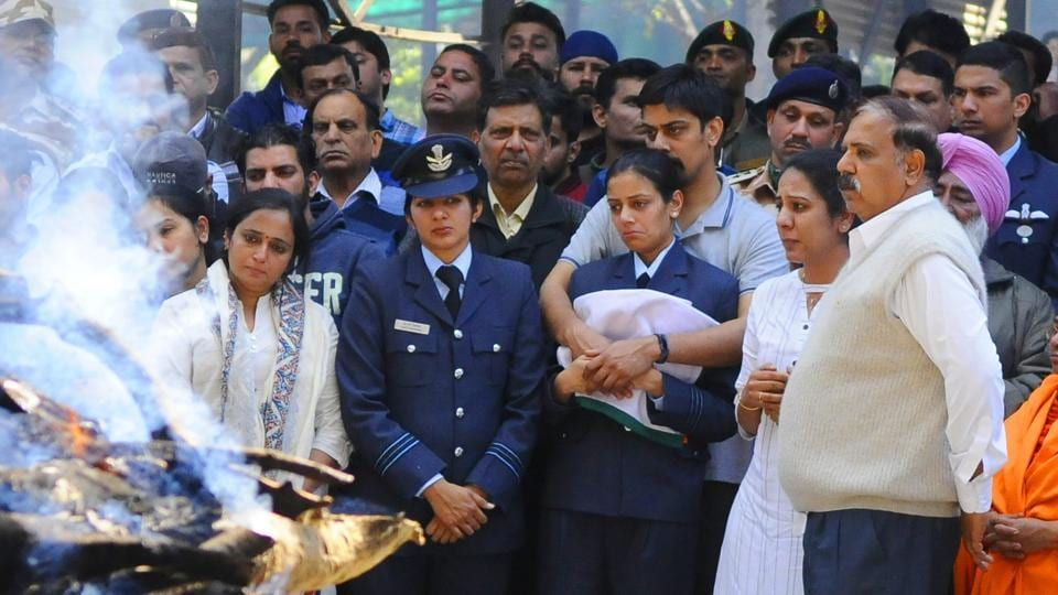 The last rites of squadron leader Siddharth Vashisht, who died in a helicopter crash in Jammu and Kashmir's Budgam district, were performed in Chandigarh, India with full military honours. In uniform, the deceased officer's wife, Aarti, who is also a squadron leader, was seen holding the tricolour. (Anil Dayal / HT Photo)