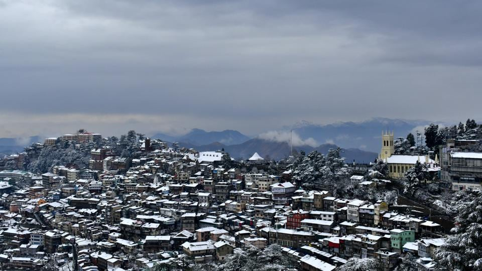 A view of snow covered rooftops and trees after fresh snowfall, in Shimla, Himachal Pradesh. (Deepak Sansta / HT Photo)