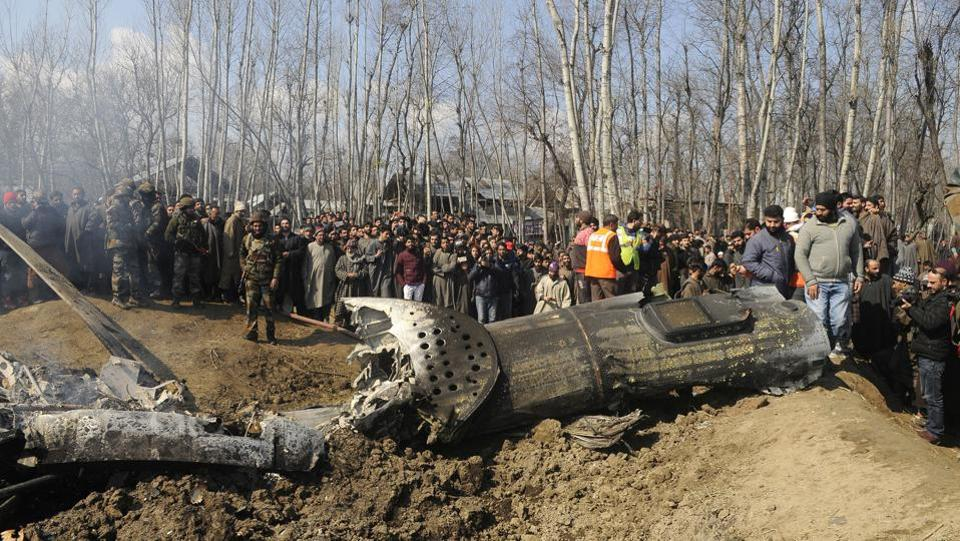 Villagers gather near the wreckage of an Indian Air Force helicopter after it crashed in Budgam area, outskirts of Srinagar, Jammu and Kashmir. (Waseem Andrabi / HT Photo)
