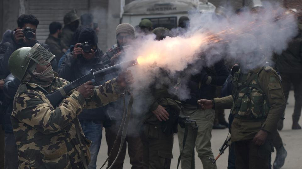 A paramilitary solider fires tear gas shell towards protesters in Srinagar, Jammu and Kashmir. (Dar Yasin / AP)