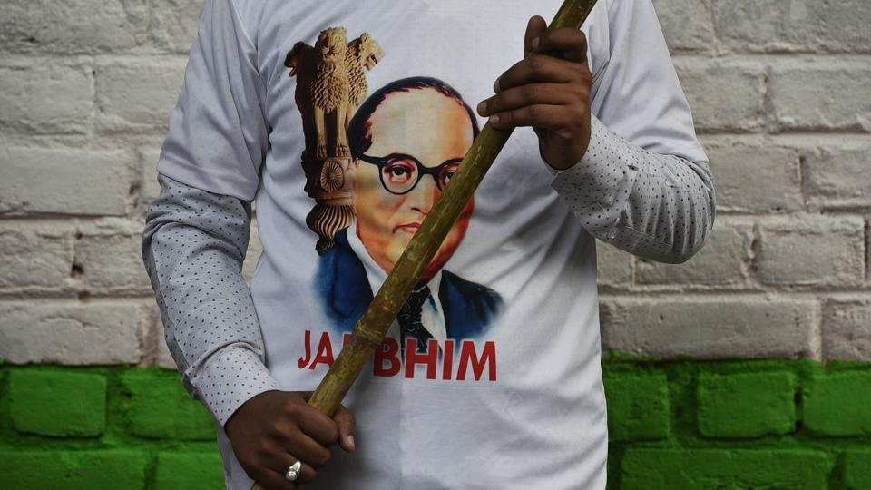 A man seen in a BR Ambedkar's face printed t-shirt during a protest against government at Jantar Mantar, in New Delhi. (Biplov Bhuyan / HT Photo)