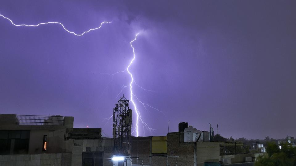 Strong lightning hit the skyline followed by heavy rain at Patel Nagar, in New Delhi. (Sanchit Khanna / HT Photo)