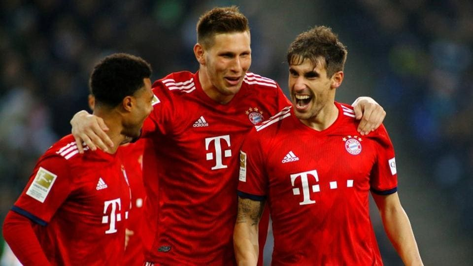 Bayern Munich's Javi Martinez celebrates scoring their first goal with team mates.