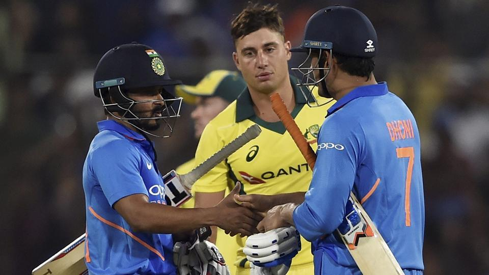 MS Dhoni and Kedar Jadhav celebrate the win against Australia.