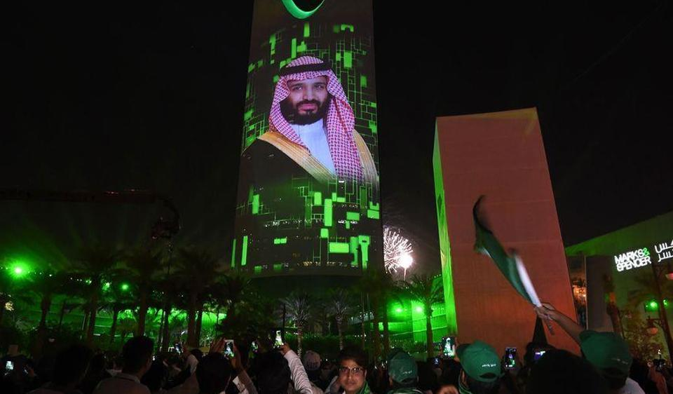 A projection of Crown Prince Mohammed bin Salman sits during national day in Riyadh.