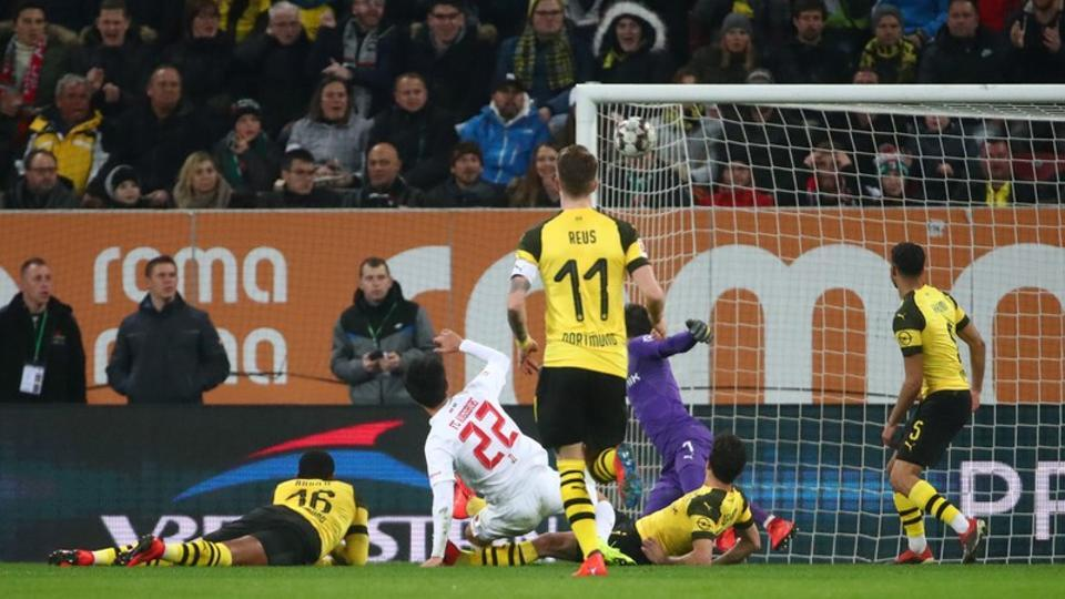 Augsburg's Ji Dong-won scores their first goal