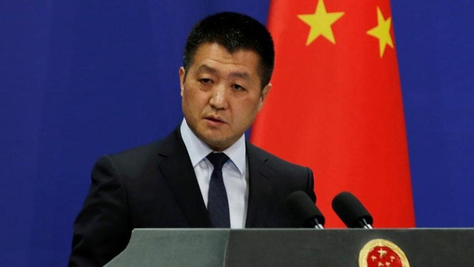 Chinese Foreign Ministry spokesman Lu Kang answers questions during a news conference in Beijing.