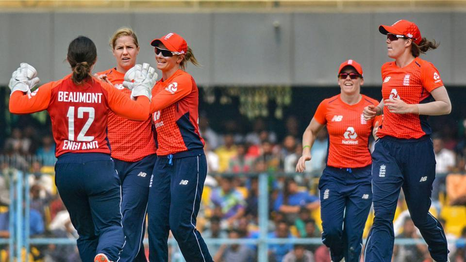England players celebrate after dismissing an India batswoman during the first T20I in Guwahati.