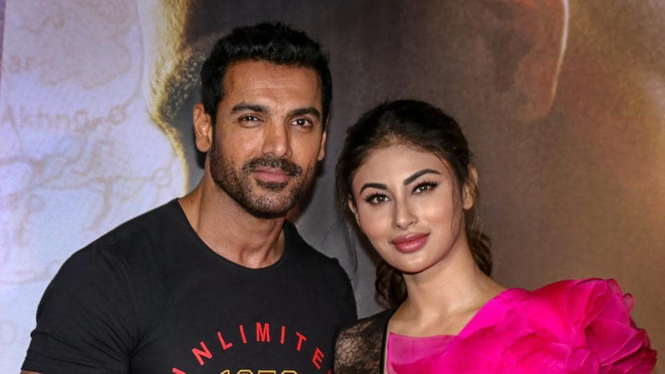 Bollywood actor John Abraham and Mouni Roy during the trailer launch of the film 'Romeo Akbar Walter', in Mumbai.
