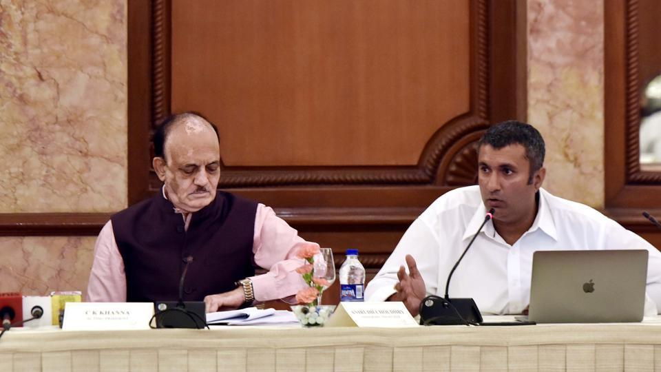 BCCI treasurer Anirudh Chaudhry (right) addresses the media after a board meeting.