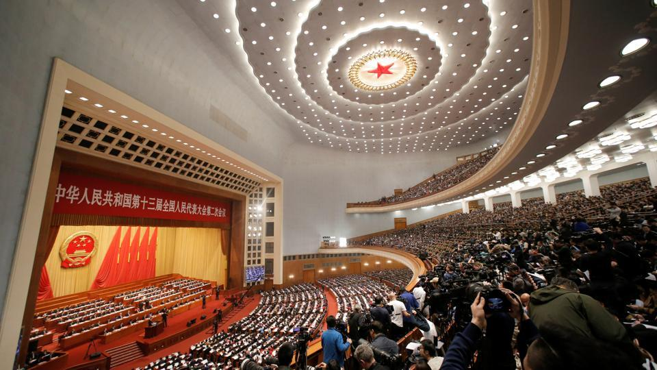 The two-week gathering of the congress's 3,000-plus delegates in the cavernous Great Hall of the People is China's highest-profile event of the year. Premier Li Keqiang told its opening session that the government is targeting growth of 6.0-6.5% this year lowering its range from 2018 and its lowest since 1990. (Thomas Peter / REUTERS)