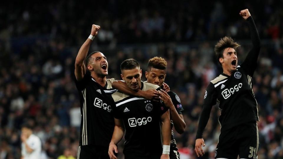 Ajax's Dusan Tadic celebrates scoring their third goal against RealMadrid with David Neres, Hakim Ziyech and Nicolas Tagliafico .