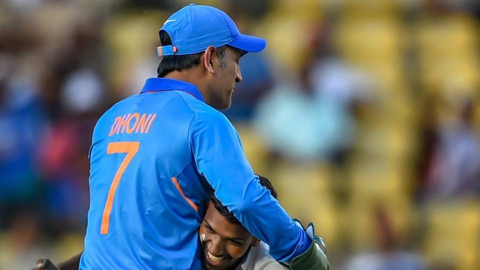 Nagpur: India's MS Dhoni accepts greetings from a pitch-invader during the 2nd ODI cricket match against Australia at Vidarbha Cricket Association Stadium in Nagpur.