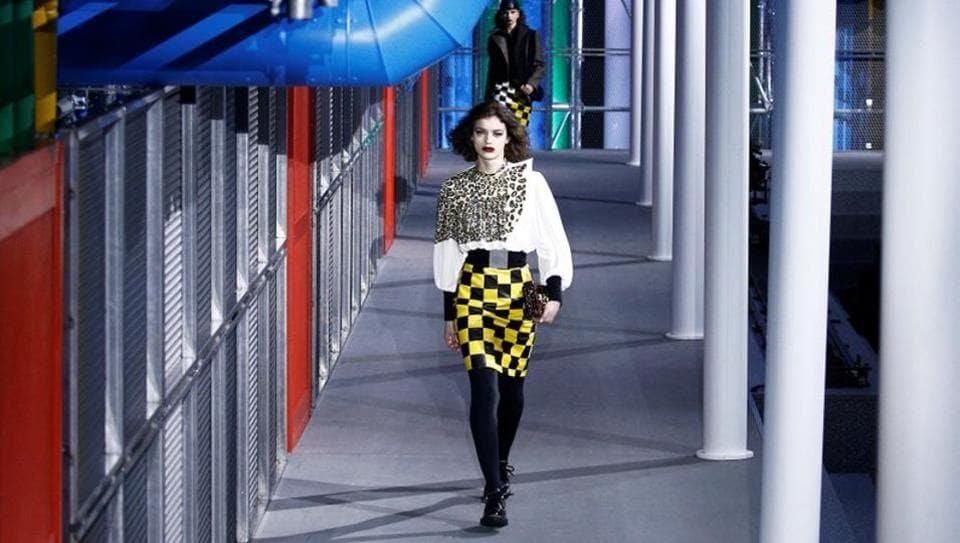 Models present creations by French designer Nicolas Ghesquiere as part of his Fall/Winter 2019-2020 women's ready-to-wear collection show for Louis Vuitton during the Paris Fashion Week.