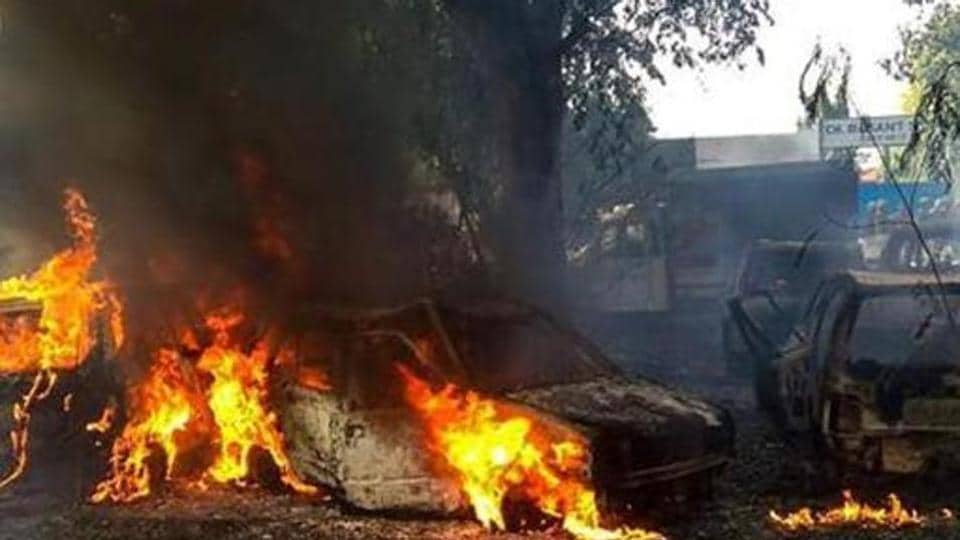 Bulandshahr: Vehicles set on fire by a mob during a protest over the alleged illegal slaughter of cattle, in Bulandshahr