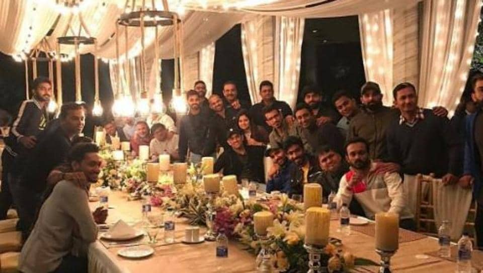 Indian cricket team players and support staff pose for a photograph during a dinner party hosted by MS Dhoni in Ranchi.