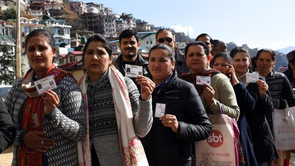 People standing in a queue during the municipal corporation elections in Himachal Pradesh.
