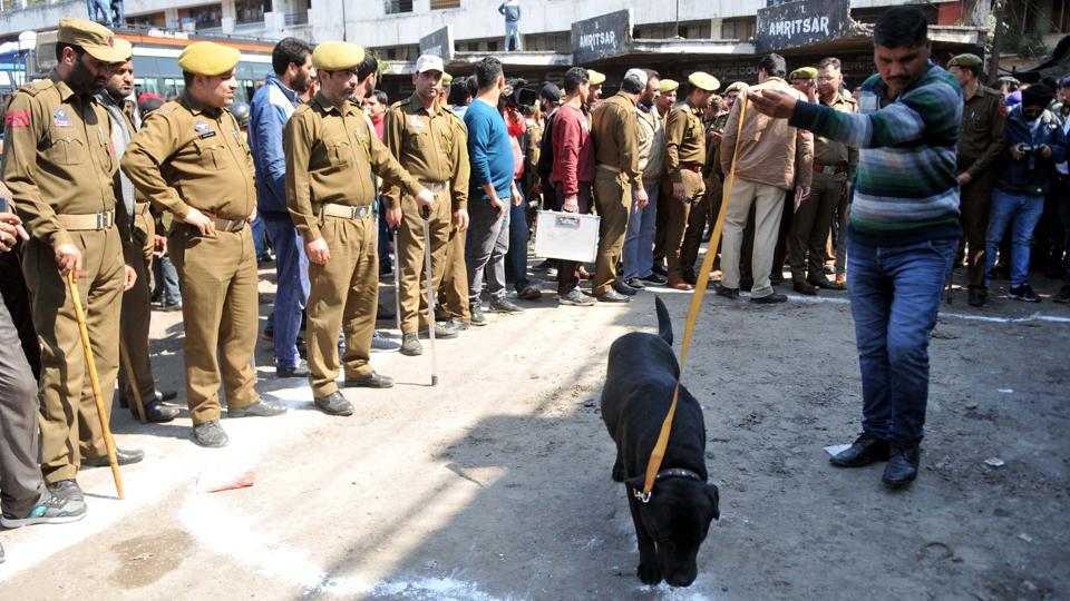 Thirty people were injured, three to four among them critically, in a powerful grenade blast around noon at the busy Jammu Bus Stand in the heart of the old city in Jammu and Kashmir on Thursday. One of the 30 people who were injured in the grenade explosion has succumbed to his injuries at the Government Medical College and Hospital. A police officer said the grenade had been placed under a bus. (Nitin Kanotra / HT Photo)