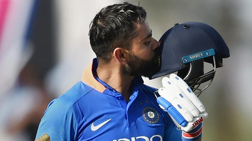 India's Virat Kohli celebrates century during the 2nd ODI cricket match against Australia at Vidarbha Cricket Association Stadium in Nagpur.
