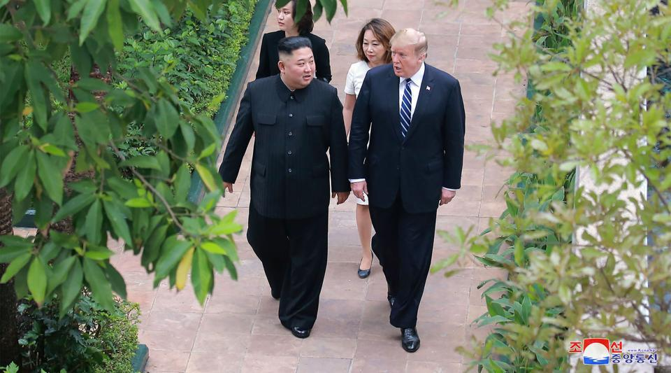 North Korean leader Kim Jong Un and US President Donald Trump walking together at the Sofitel Legend Metropole hotel in Hanoi, February 2019.