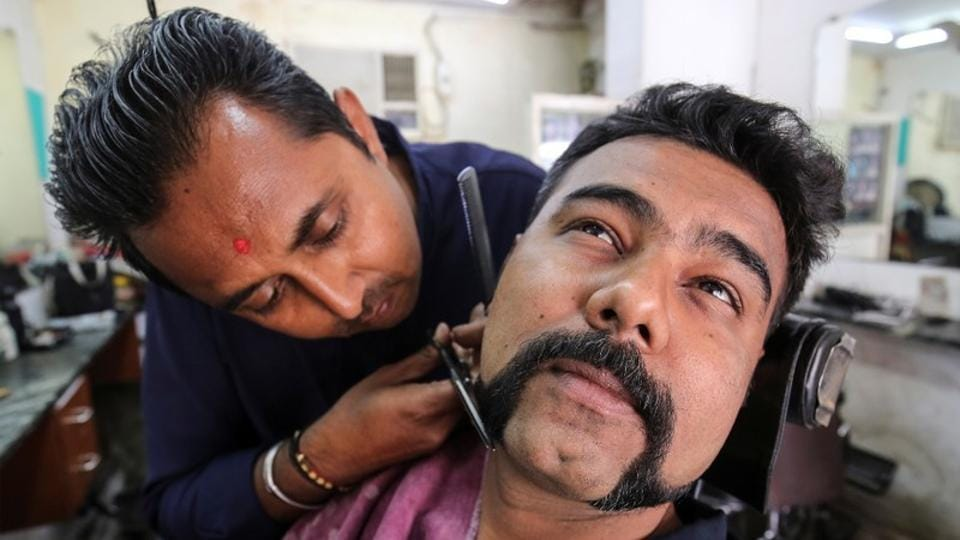 Dhiren Makvana gets his moustache trimmed similar to the one sported by Indian Air Force pilot Abhinandan Varthaman, who was captured and later released by Pakistan, inside a salon in Ahmedabad, Gujarat. (Amit Dave / REUTERS)