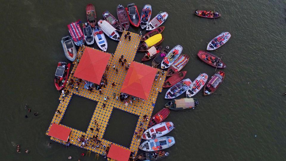 Boats tethered at Sangam, the confluence of sacred rivers Yamuna, the Ganges and the mythical Saraswati as devotees take holy dips on the auspicious day of Maha Shivratri during the last day of Kumbh Mela, in Prayagraj, Uttar Pradesh. (Rajesh Kumar Singh / AP)
