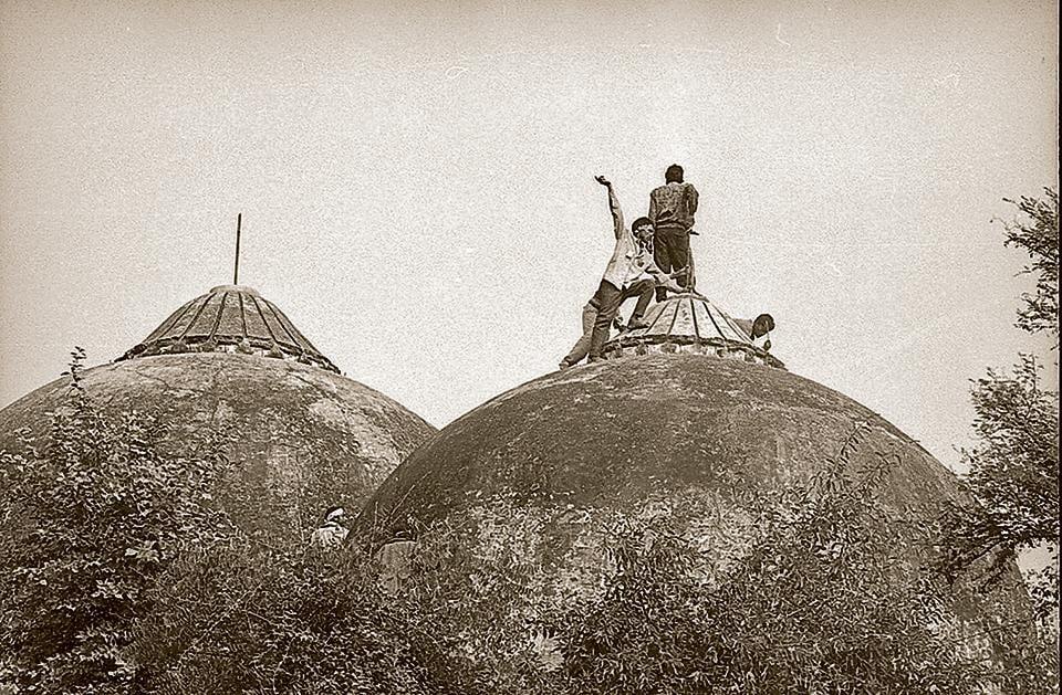 People climbing onto the Babri Masjid in Ayodhya, Uttar Pradesh, December 6, 1992