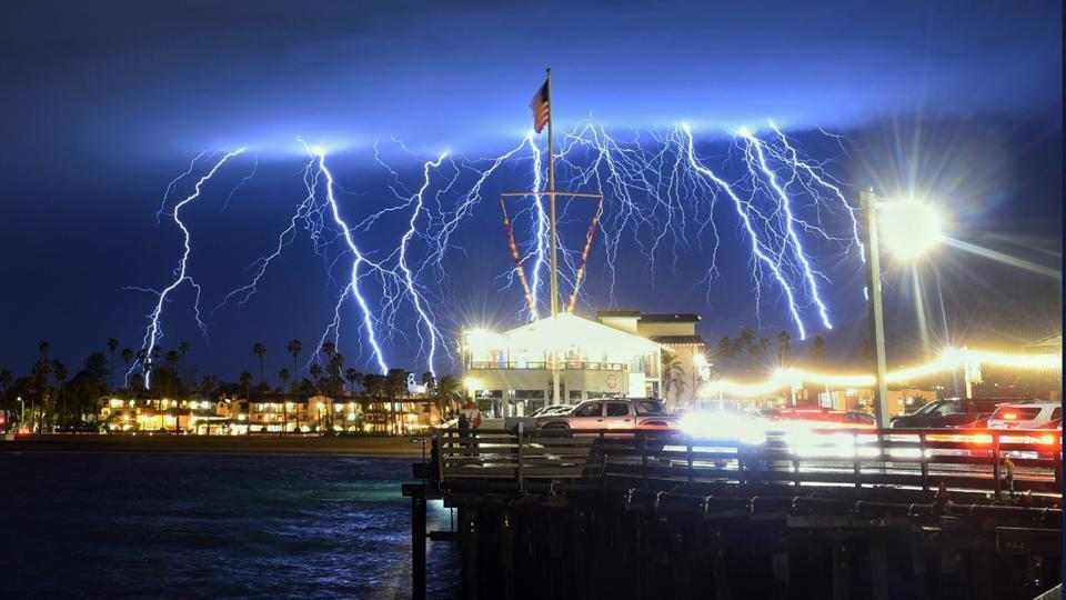 A long exposure photo shows a series of lightning strikes over Santa Barbara, California, seen from Stearns Wharf in the city's harbor. (Mike Eliason / Santa Barbara County Fire Department via AP)