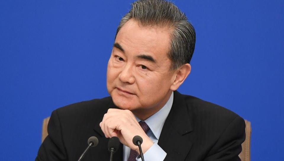 China's Foreign Minister Wang Yi listens during a National People's Congress press conference in Beijing on March 8, 2019.