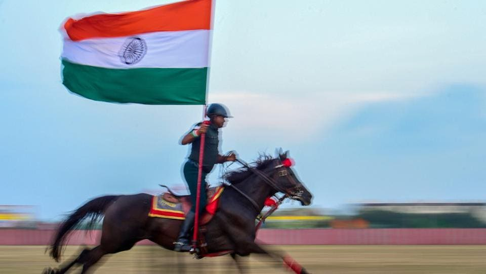 An army personnel holding the tricolour displays his horse-riding skills during the combined display of martial arts and combat skills by the cadets at Officers Training Academy in Chennai, Tamil Nadu. (PTI)