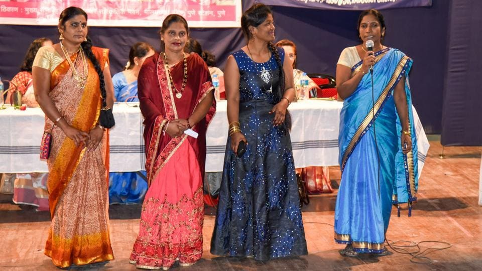 Maids belonging to different communities dress up in their traditional attire and take part  in the Women's day celebration program organised by Green Tara Foundation and Maid hub organisation at Ambedkar hall on Friday. (SANKET WANKHADE/HT PHOTO)