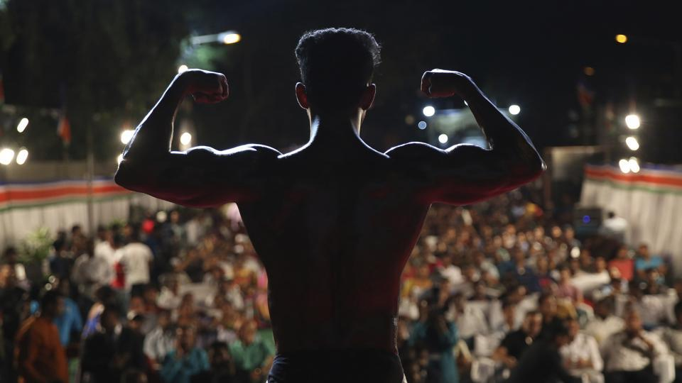 A body builder displays his muscles during the Mumbai Bodybuilding competition in Mumbai, Maharashtra. (Rafiq Maqbool / AP)