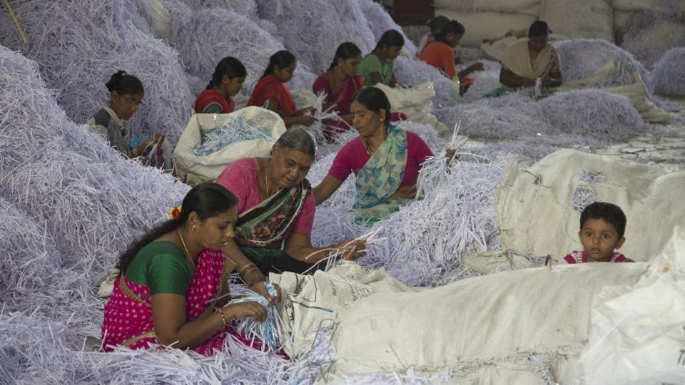 Women work at a paper recycling unit on International Women's Day, in Hyderabad, Telangana. (Mahesh Kumar A. / AP)