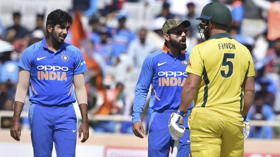 Kohli has a heated exchange with Australia's skipper Aaron Finch as Jasprit Bumrah looks on.  (PTI)