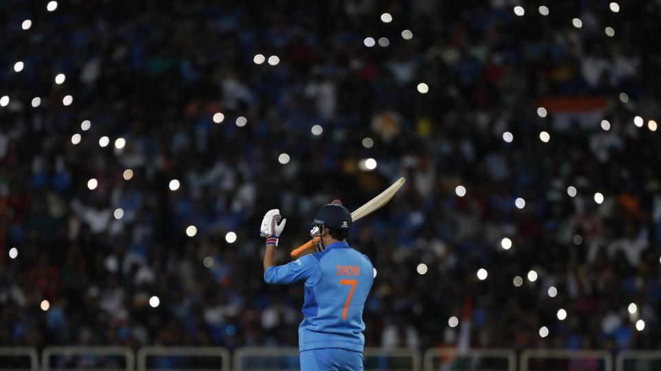 Mahendra Singh Dhoni prepares to bat during the third one day international cricket match between India and Australia in Ranchi, Jharkhand. (Aijaz Rahi / AP)