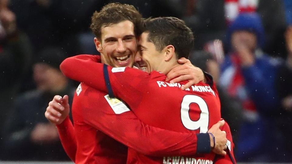 Bayern Munich's Robert Lewandowski celebrates scoring their sixth goal with Leon Goretzka.