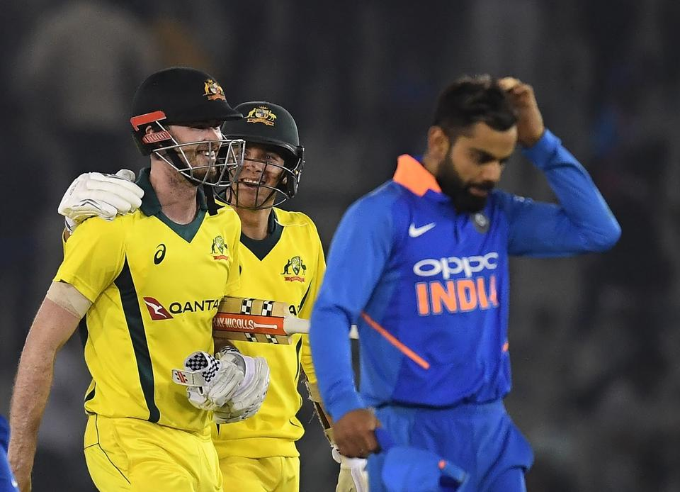 Australia cricketer Ashton James Turner (left), Jhye Richardson (centre) and Indian cricket captain Virat Kohli (right) walk back to the pavilion after the fourth one-day international of the recently concluded bilateral series, Mohali, March 10
