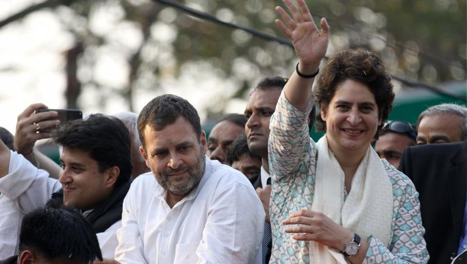 Congress president Rahul Gandhi looks on at a rally as party general secretary Priyanka Gandhi Vadra  waves to supporters in Lucknow.