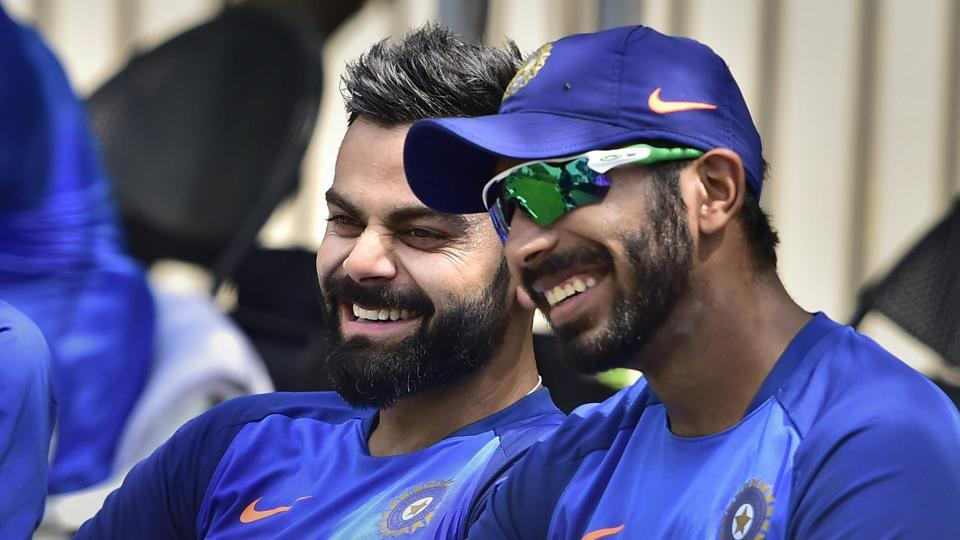 File image of India cricketer Jasprit Bumrah and Virat Kohli (L).