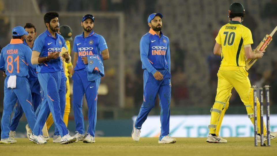 Indian skipper Virat Kohli along with teammates walk off the field after the fourth ODI against Australia.