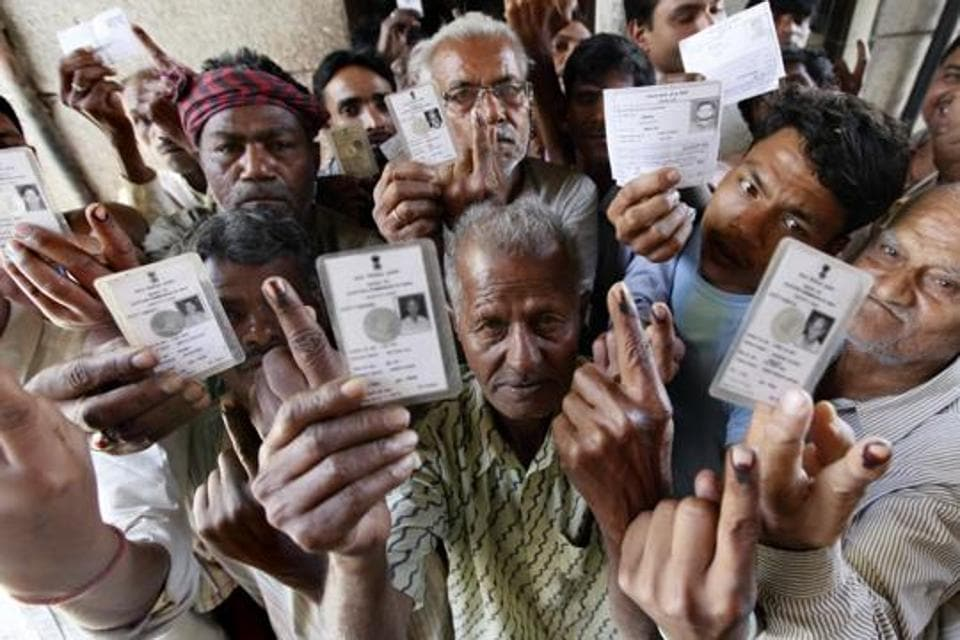 West DelhiElection Results 2019: Voters show their inked fingers in 2014 after casting their votes for Lok Sabha elections at Chandni Chowk in New Delhi.