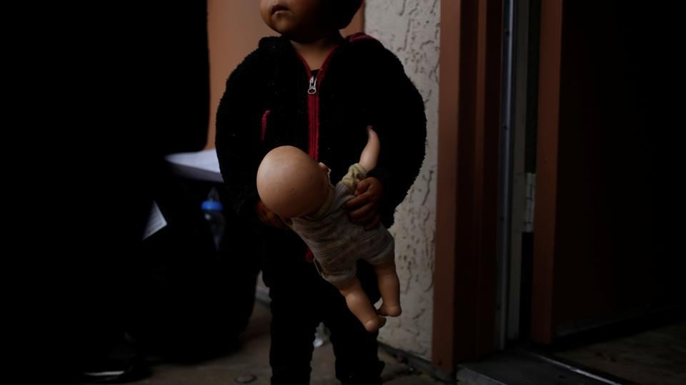 A young migrant holds a doll she arrived with at a motel in Tucson, Arizona, United States. A motel and a monastery are among several pop-up shelters that have opened in the last six months in Arizona to house a rising number of migrants from Central America entering the United States to seek asylum. (Nicole Neri / REUTERS)