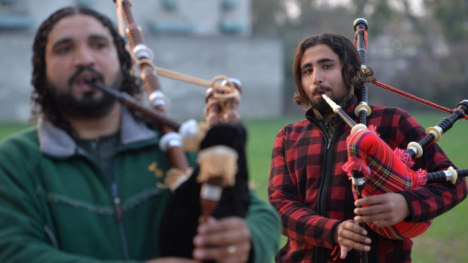 A musical band performs with bagpipes made at the Mid East bagpipe factory in the city of Sialkot, Pakistan. The fresh smell of wood floats through the Mid East factory on the eastern side of Pakistan's Punjab province, where third generation owner Umer Farooq (not pictured) is one of the managers. Workers are busy standing or sitting on the ground. (Aamir Qureshi / AFP)