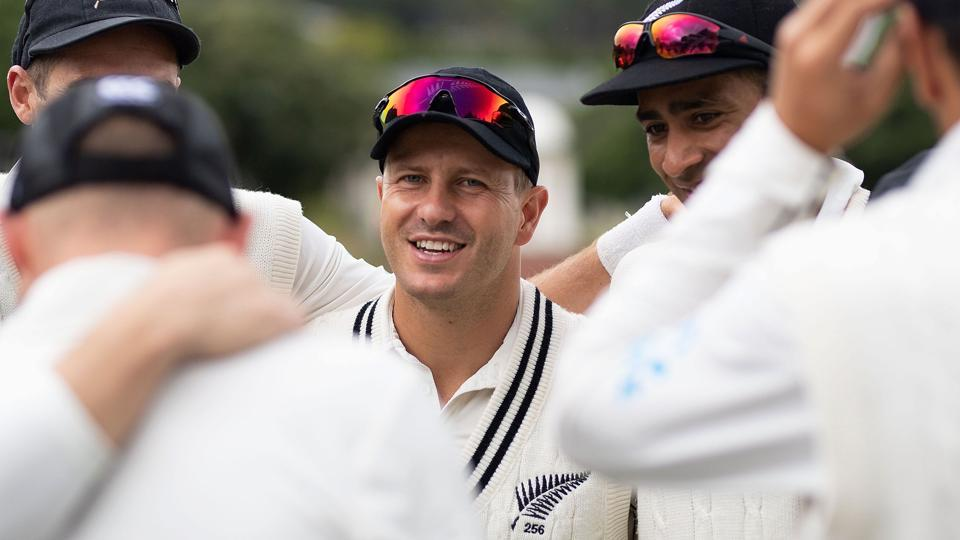 New Zealand's Neil Wagner (C) huddles with teammates during day five of the second cricket Test match between New Zealand and Bangladesh at the Basin Reserve in Wellington on March 12, 2019
