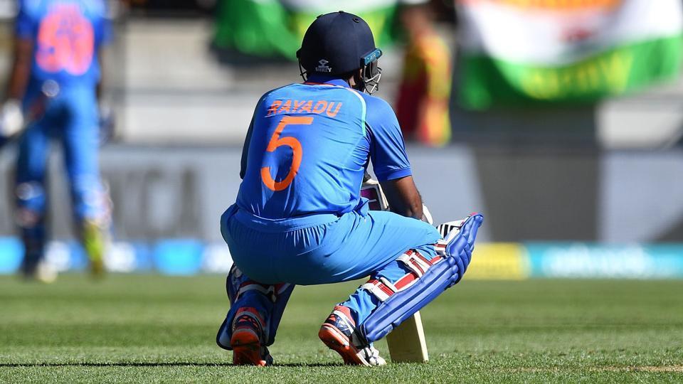 Ambati Rayudu (C) reacts as teammate Vijay Shankar (back L) walks from the pitch.