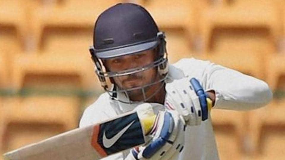 Karnataka's Manish Pandey plays a shot.